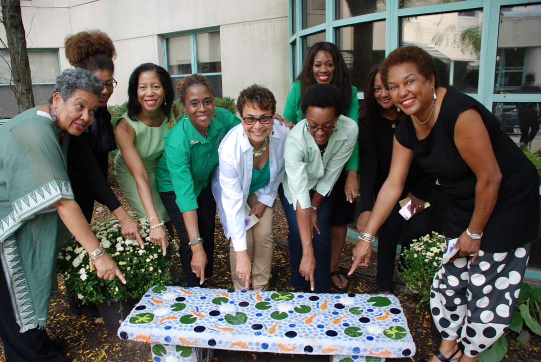 LINKS Volunteers celebrating the completion of the mosaic project