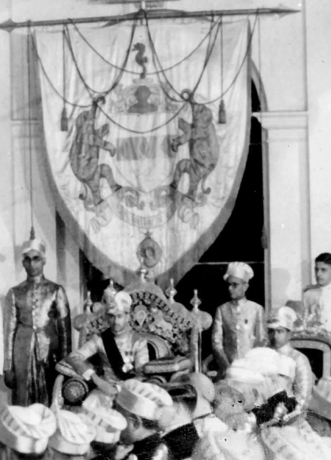 Birthday Durbar of Maharaja Chithira Thirunal Balarama Varma, c.1930s. In the background, the royal banner presented to Maharaja Ayilyam Thirunal Rama Varma in 1877.