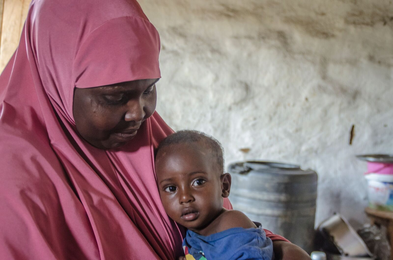 (Ayeeyo from Somalia, and her  grandson , Nakivale Refugee Camp)