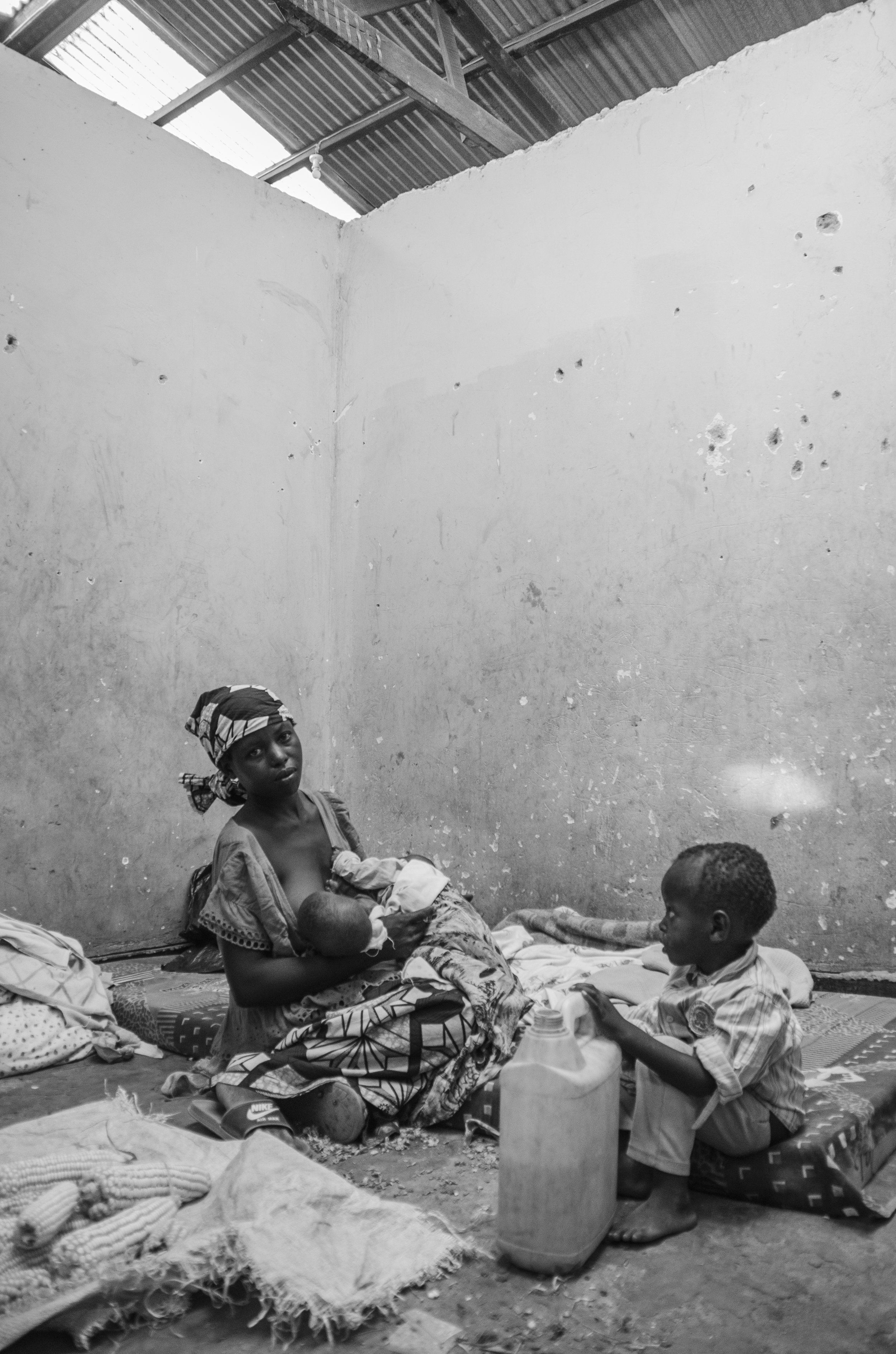 (Nayigiziki and her three boys from Burundi, Reception Centre, Nakivale Refugee Settlement)