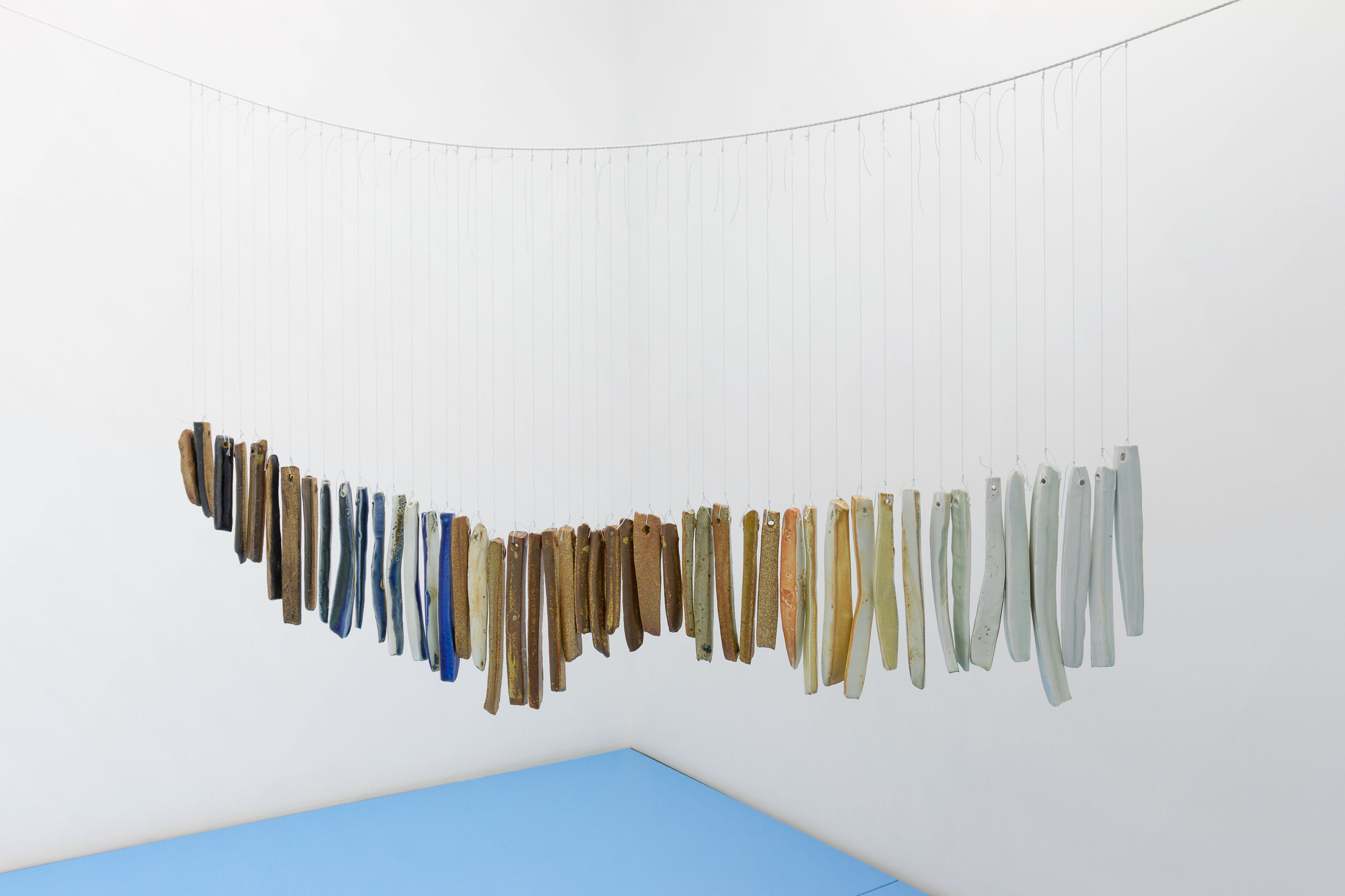 I feel like a truck on a wet highway    String, thread, porcelain, stoneware, glaze, paint.