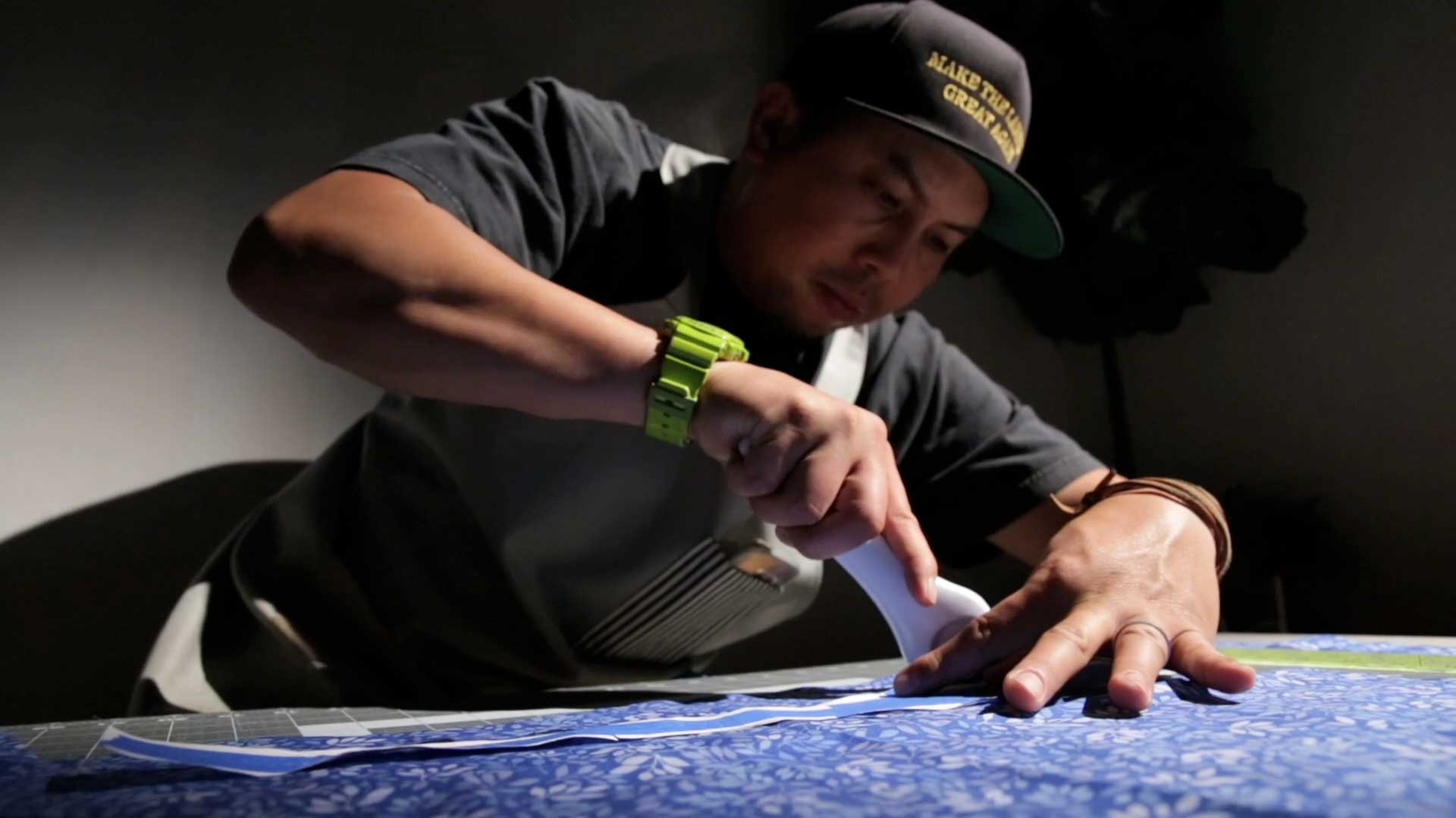 Andy Alvarado busy crafting some ties