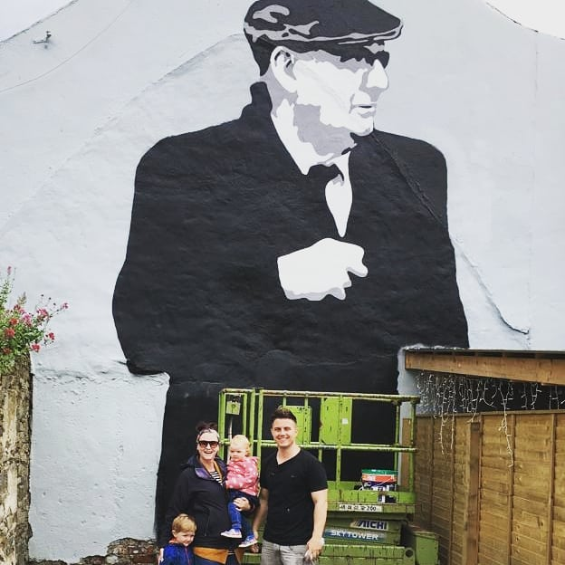 """How cool is this! Today we brought the kids down to see our friend @bradyjjbrady (who is an amazing artist!) at work! He has created this mural on the side of @thebusbarskerries and it just looks unreal. Cant wait til hes rich and famous so I can say """"i know him!!"""" 🤗 Ps if you knew the person in the mural you would be stunned at the likeness, he got it spot on! #art #skerries #streetart #mural #muralart"""