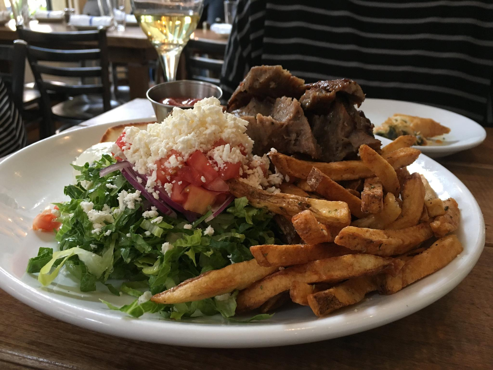 Gyros with Greek salad and yes, French fries because who wants rice with lunch?