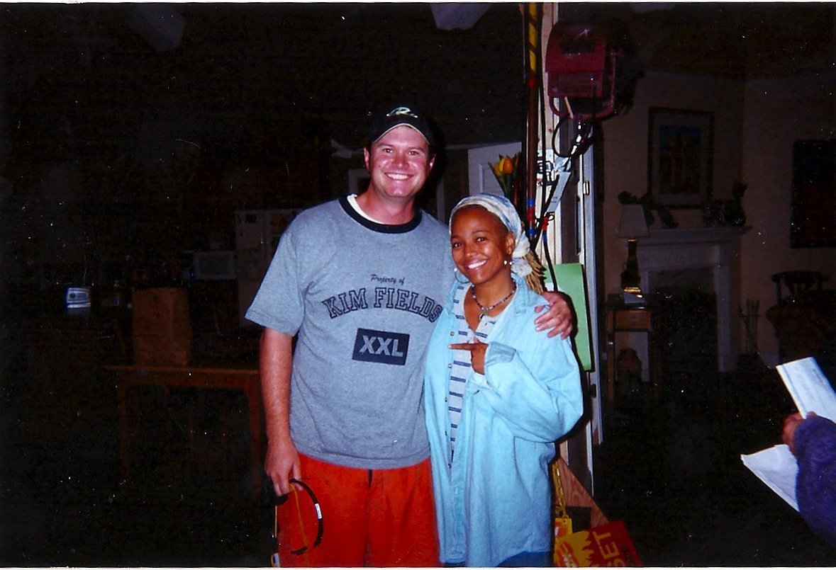 "With Kim Fields on the set of Nickelodeon's ""Taina"".  My last job as a PA.  Kim ran me like crazy so I made this shirt as a joke."