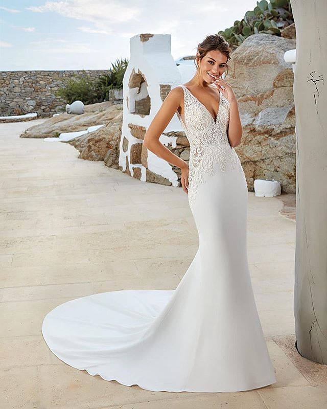 Just got this stunning crepe gown in from @eddyk_bridal Features a sheath silhouette, and a beautiful beaded bodice that's sure to turn heads! ✨