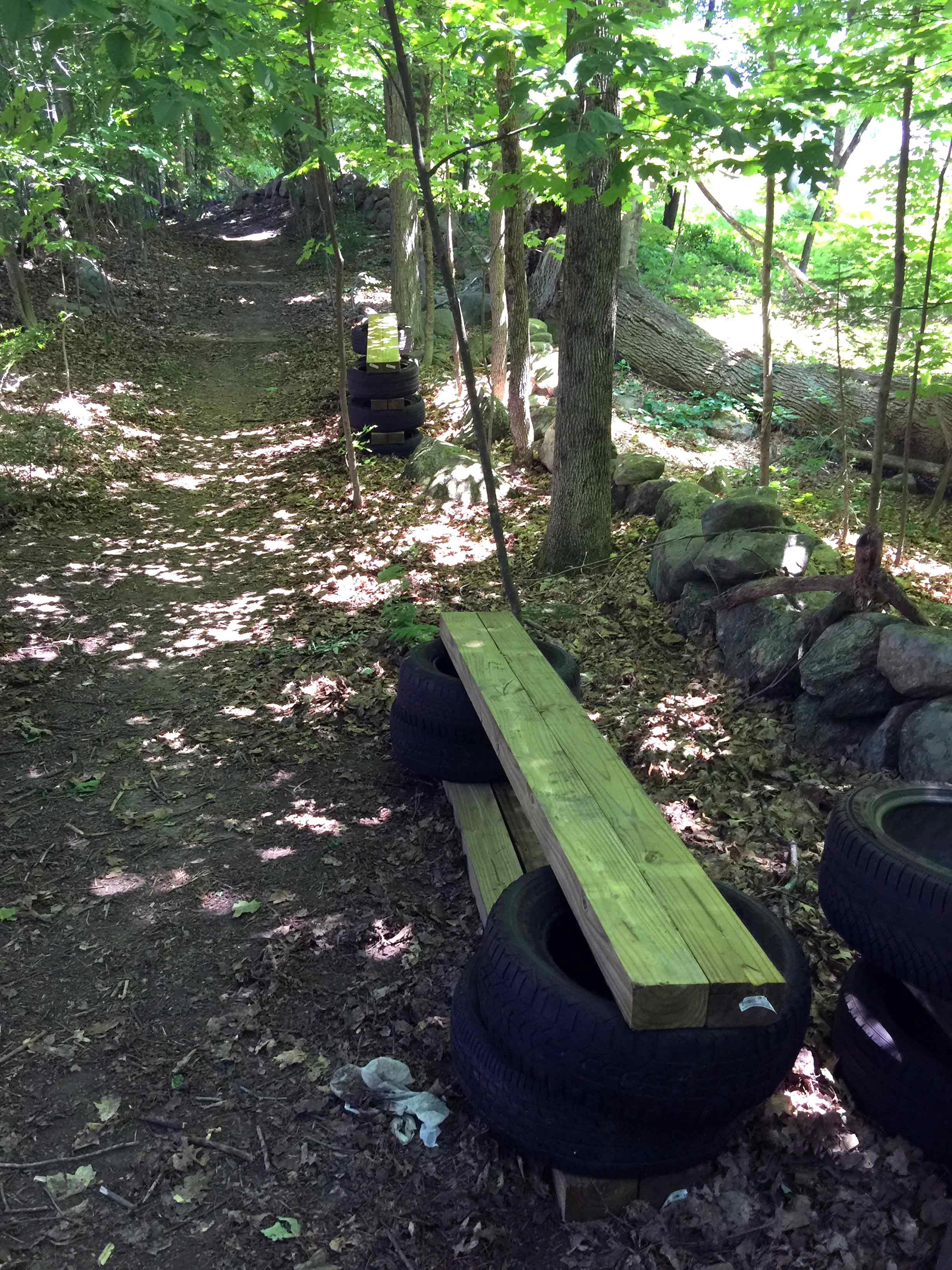 Pre-built bog bridges await installation