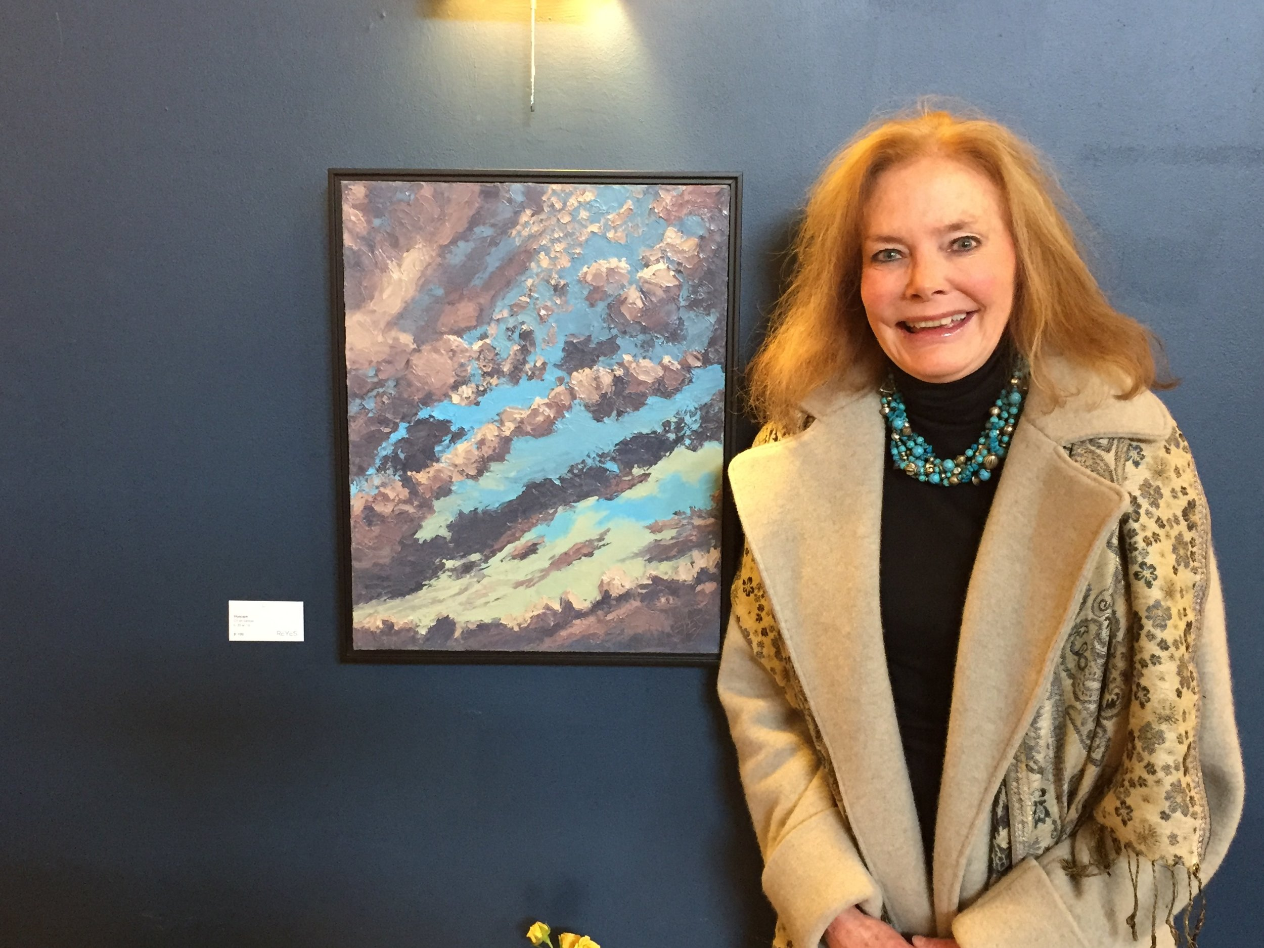 """Lisa with her favorite (and color coordinated!) painting of the show, """"   Skyscape   """""""