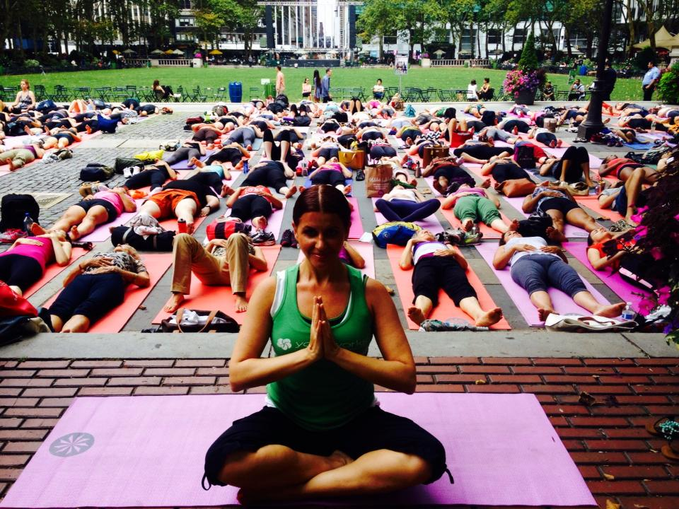 Julie teaching yogis in Bryant Park.