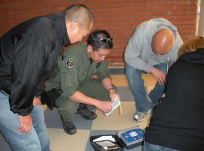 Joe Nakagawa, M.D. '00 (center), during defibrillator training.