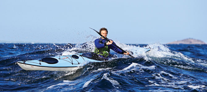 Nigel Foster surfing the composite Whisky 16. Photo:  Point 65 Sweden .