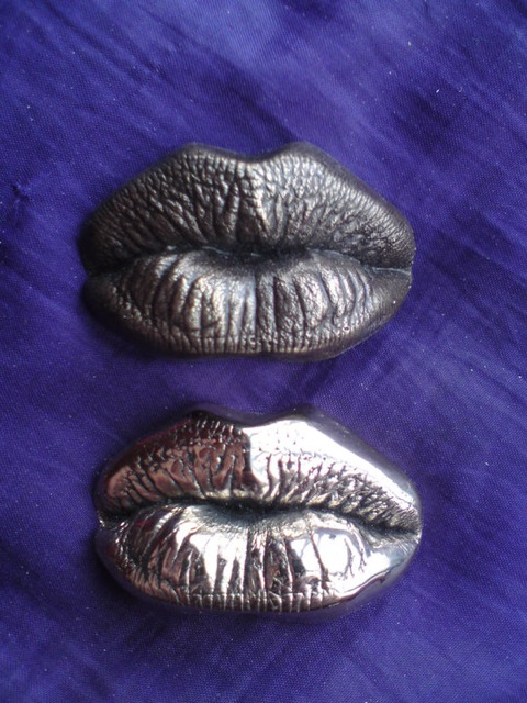 real bronze kiss casts (patinated and polished).jpeg