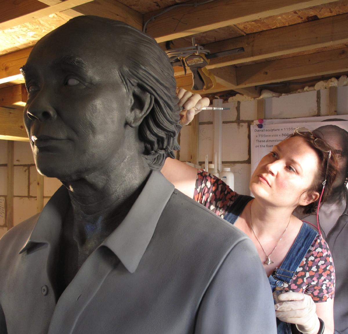 CJ Munn sculpting large memorial