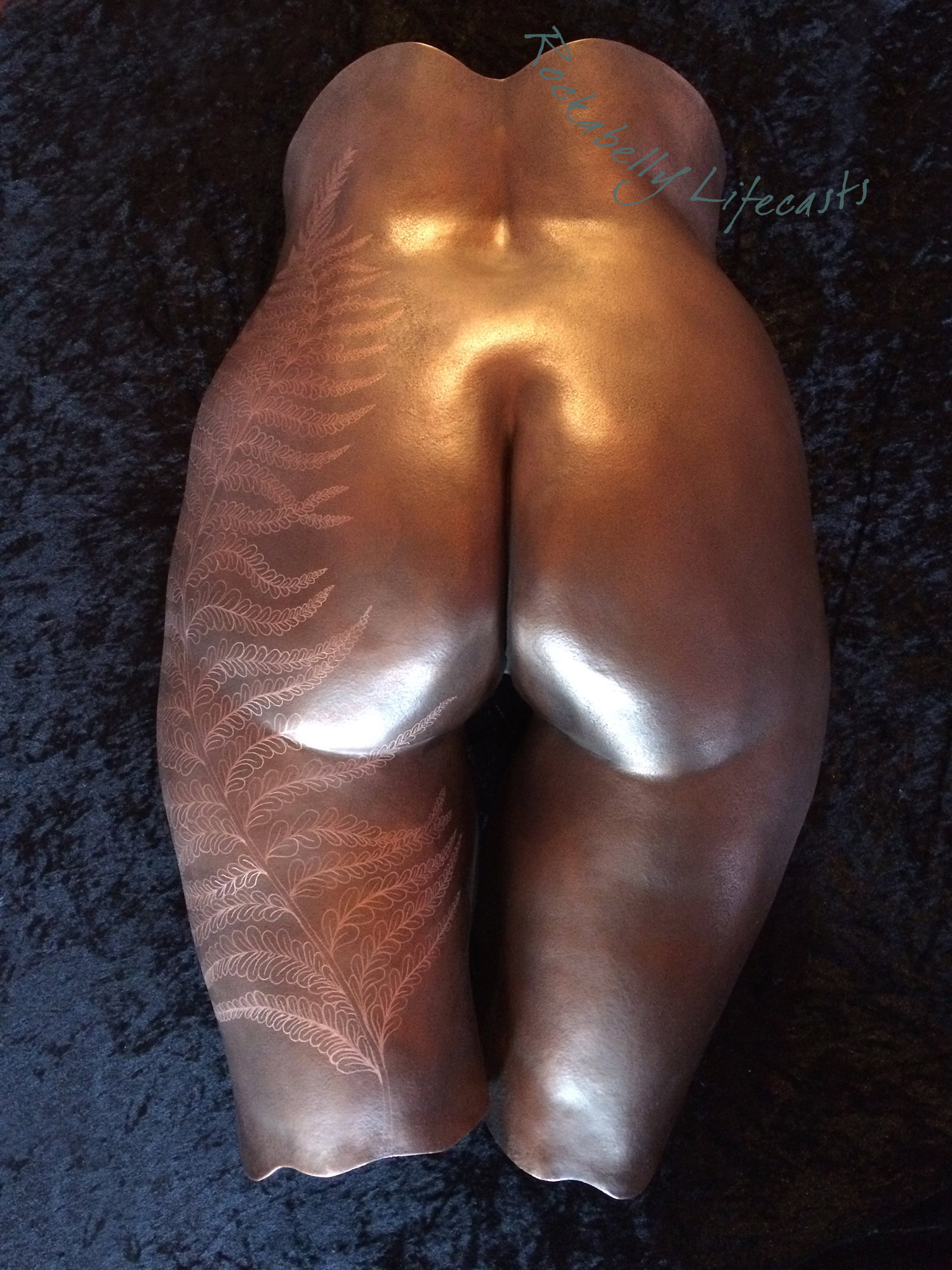 Copper veneer over plaster cast with hand-engraved fern design.