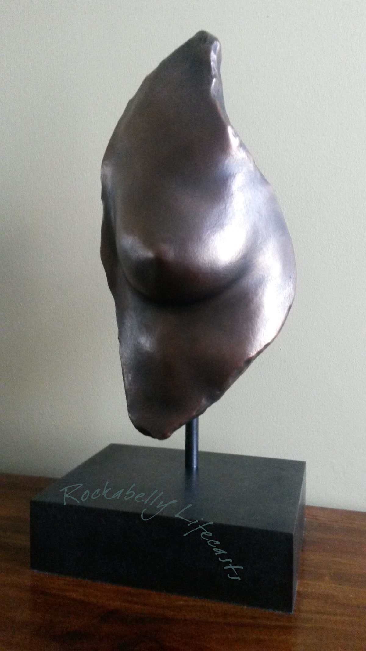 Pre-mastectomy breast cast with copper veneer.