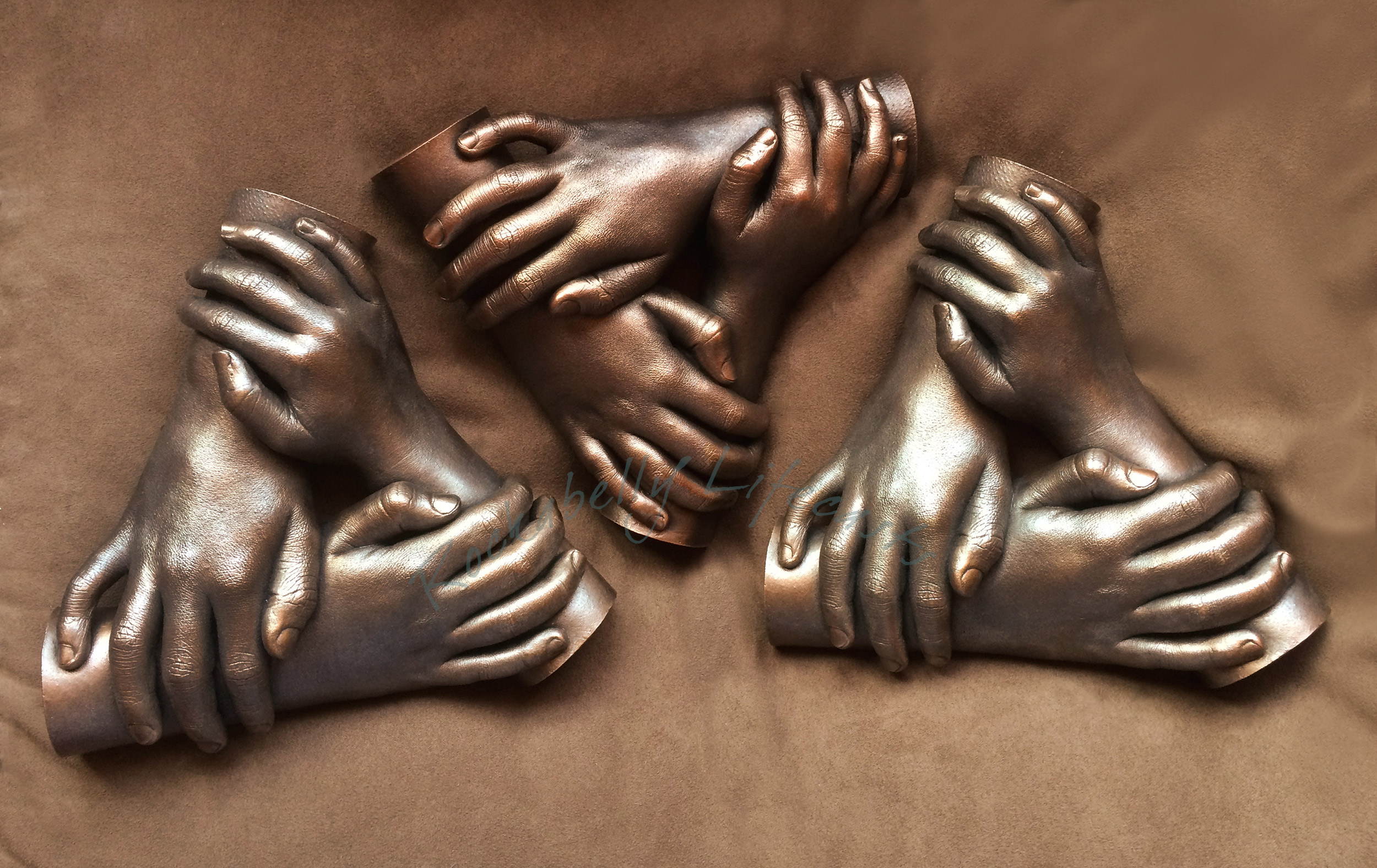 Family group hand casts in cold cast copper and faux metal.
