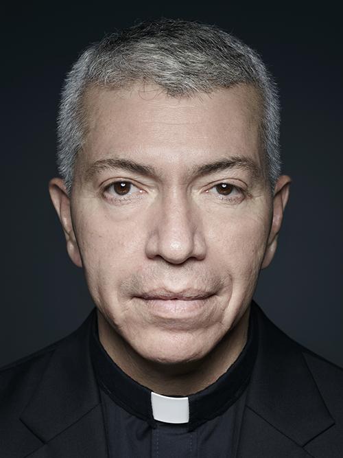 Fr. John Galvan's formal headshot.