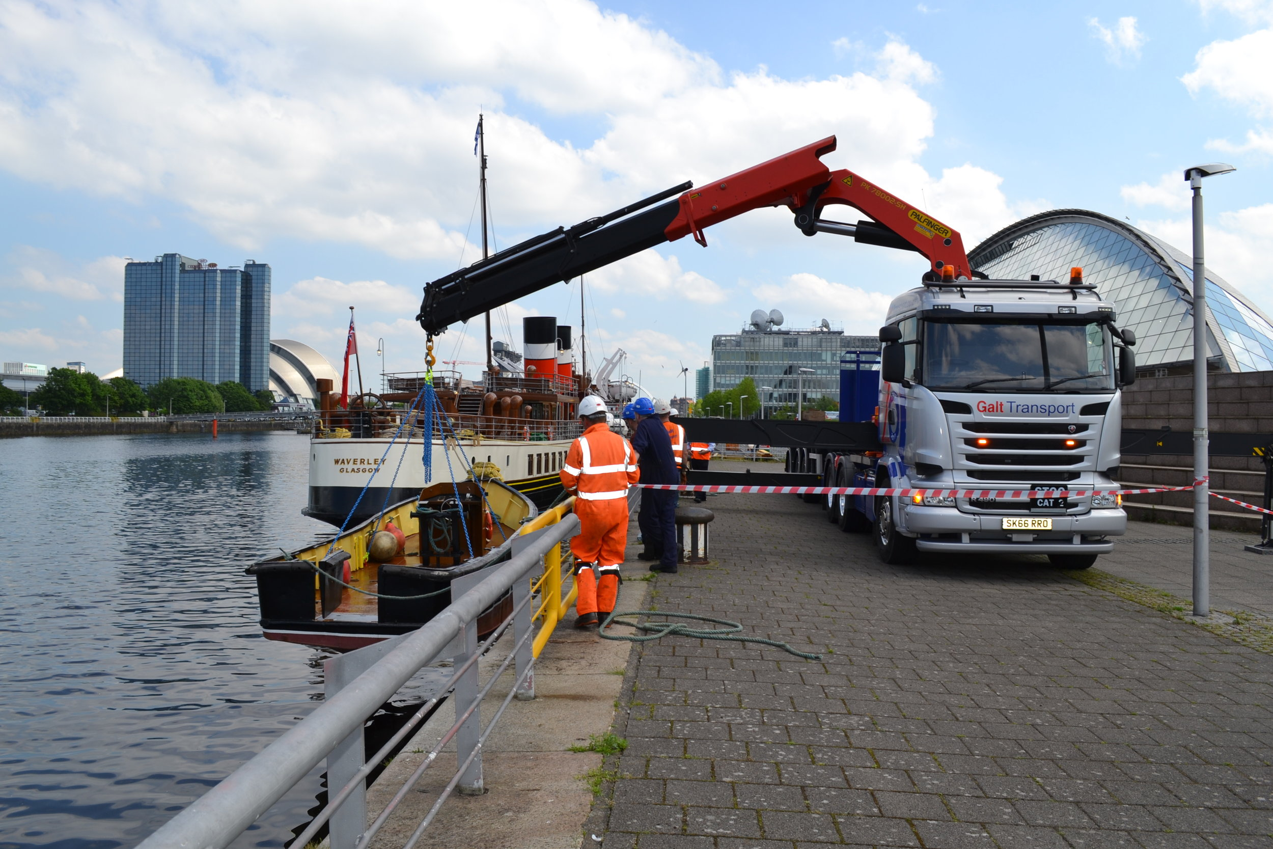 The work boat is lowered into the water