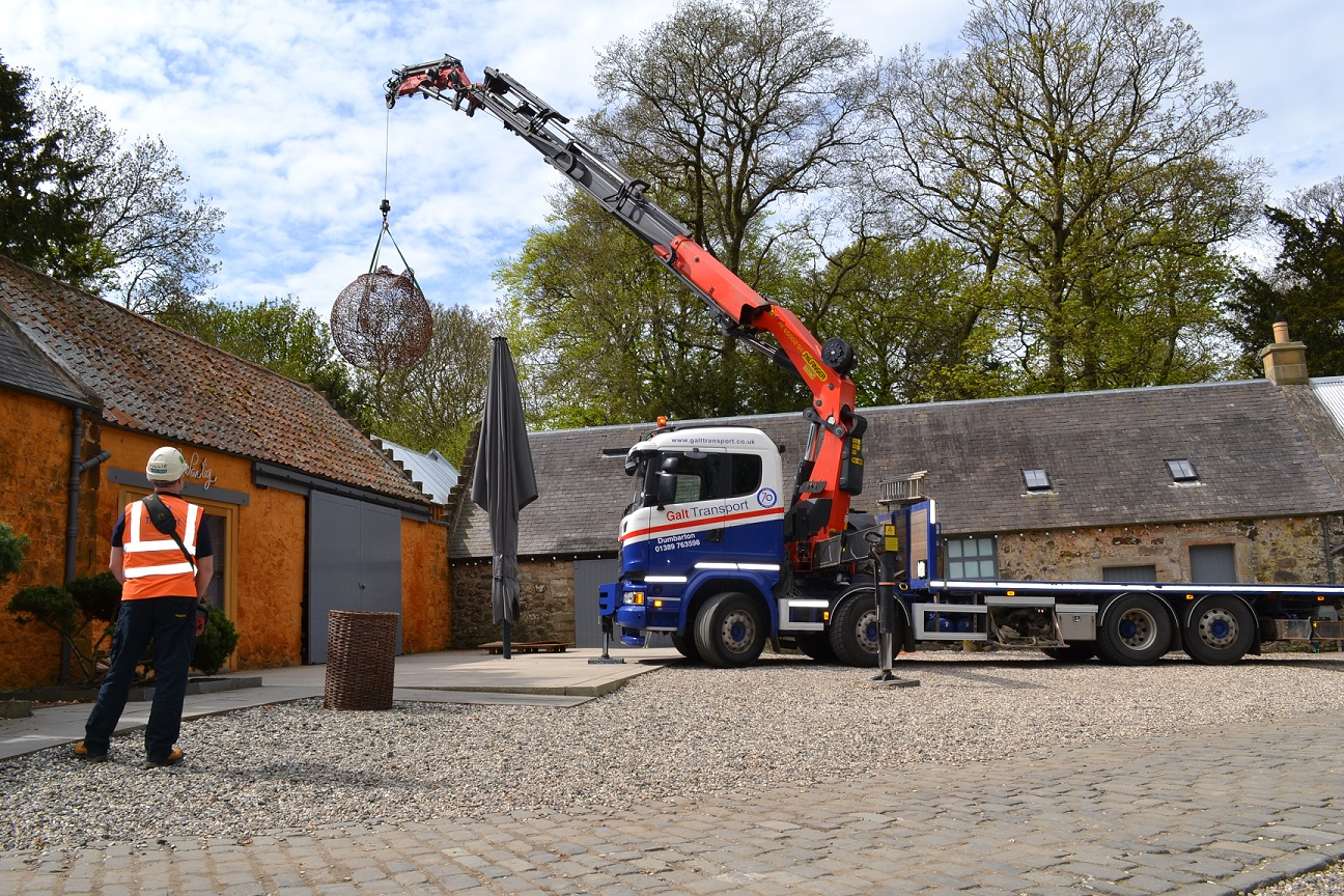 craning the sculpture over cafe party