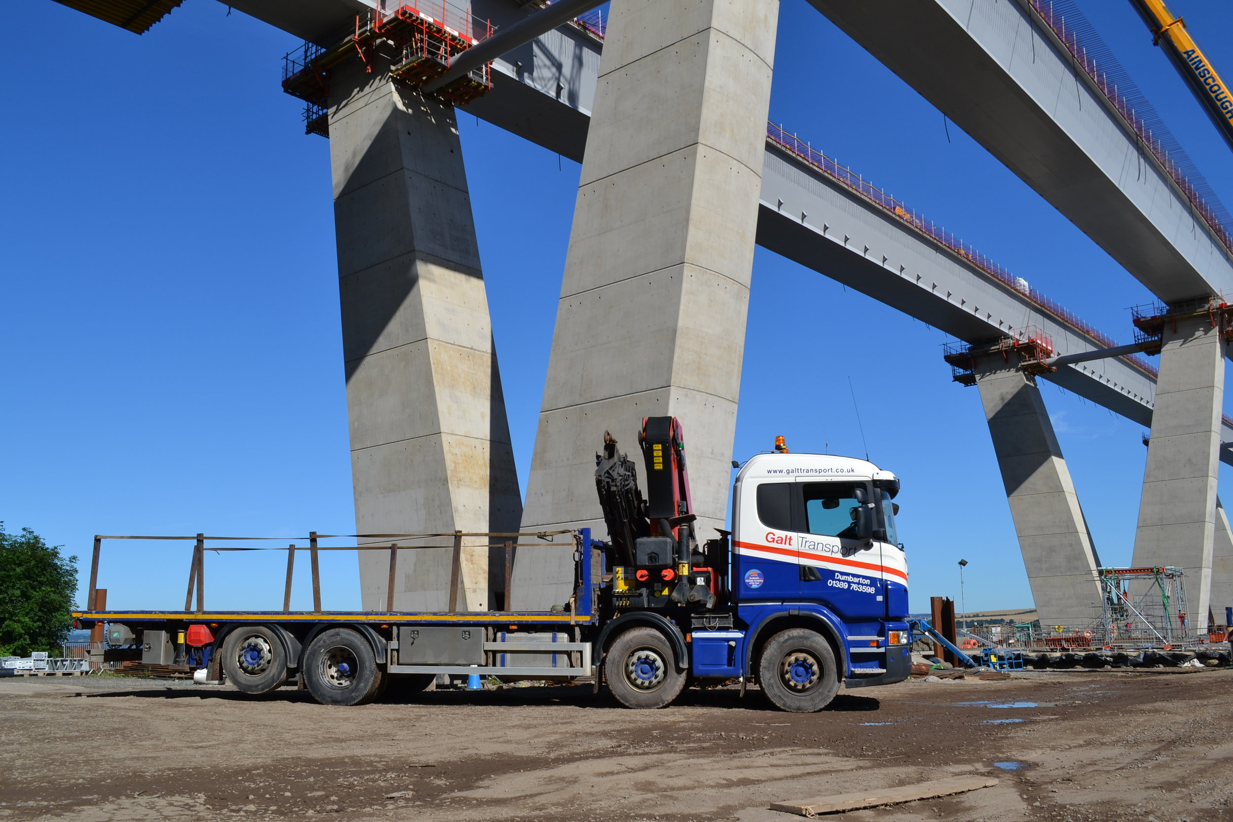 A rigid hiab with front mounted crane
