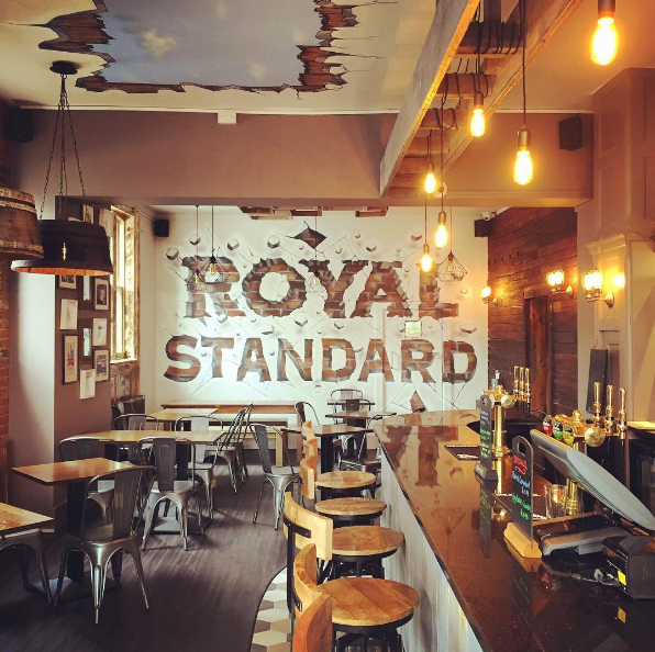 A forgotten seedy pub on Tanners Hill has been transformed into a very good one that serves food and now real ale, not just craft beer. The trompe l'oeil on the ceiling and on the typography on the wall is a first for the area.