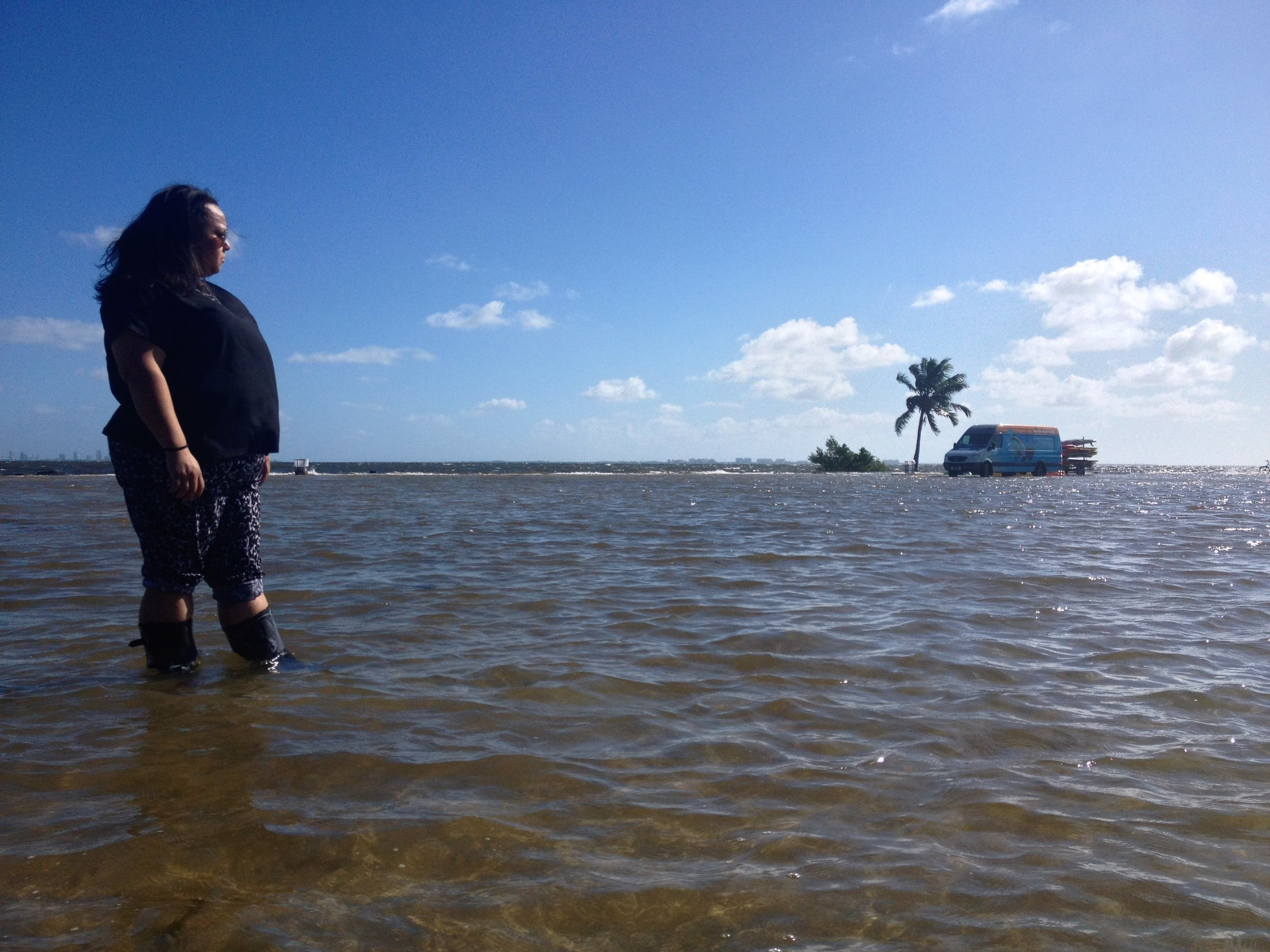Karina in her rainboots during the king tides flooding event of October 2016. Photo: Dayna Reggero, Climate Listening Project.