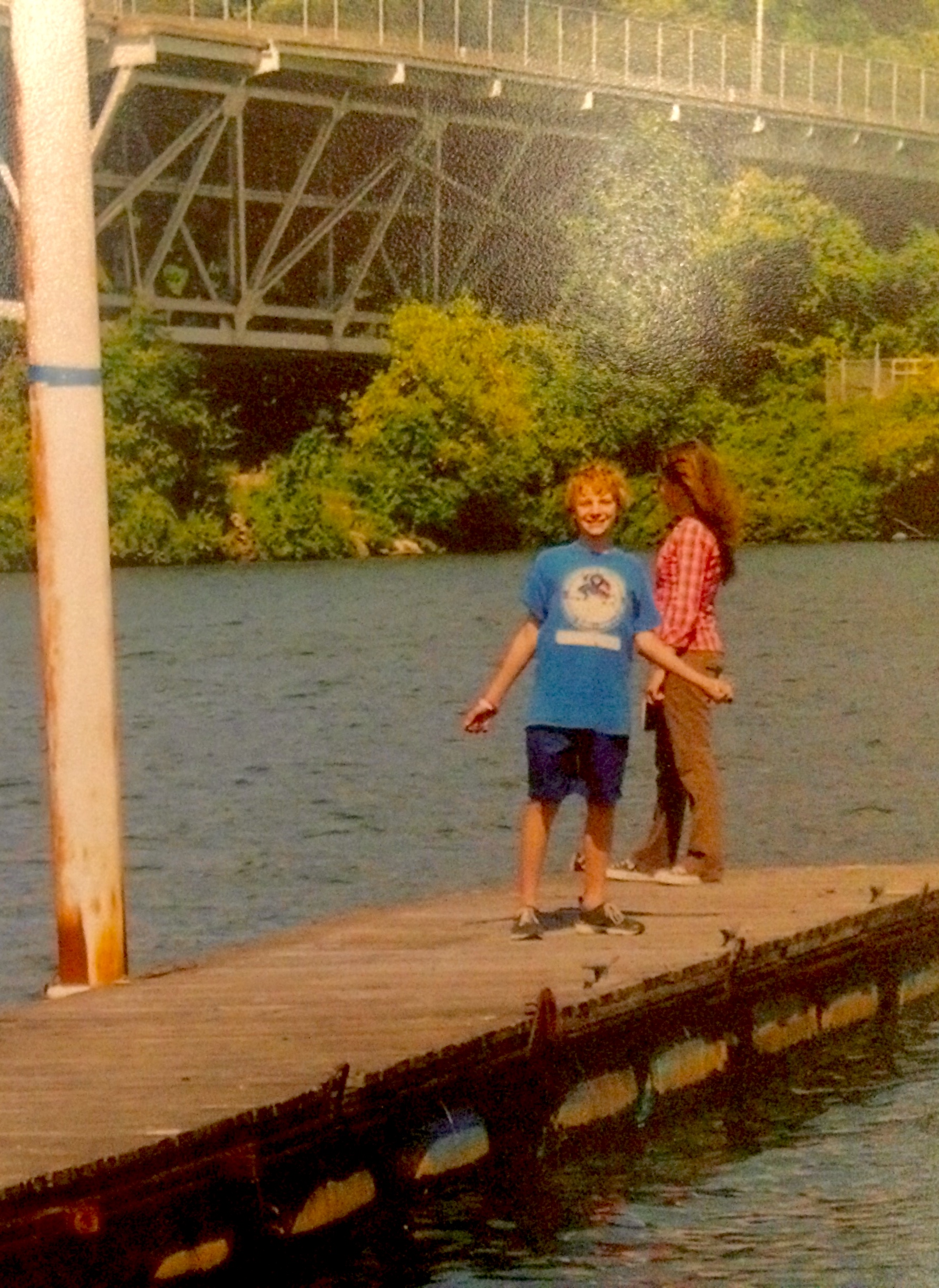 Kayla and her little brother as kids on a fishing dock.