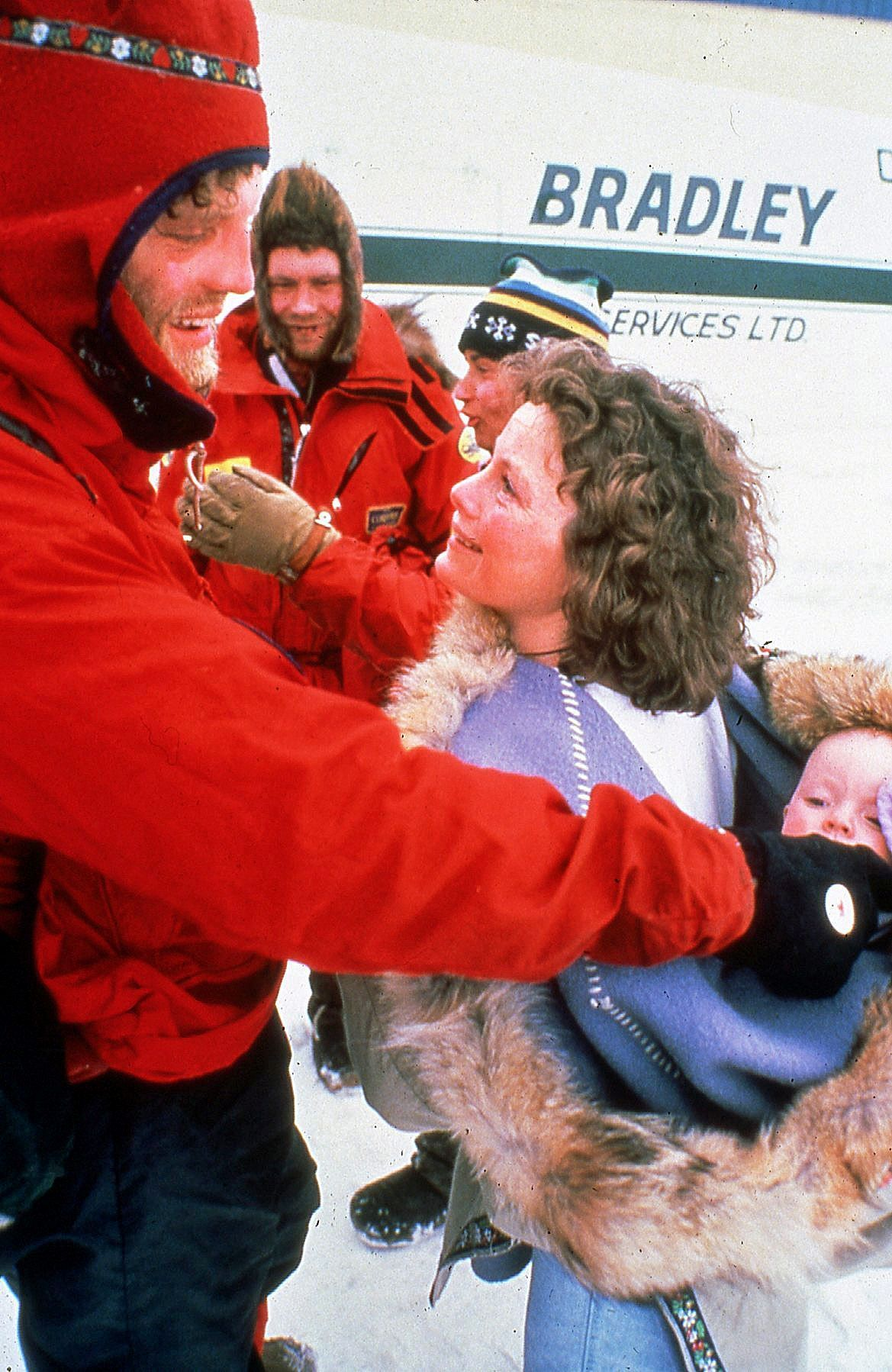 Paul meeting his wife, sue, and their baby after finishing a North Pole trip.