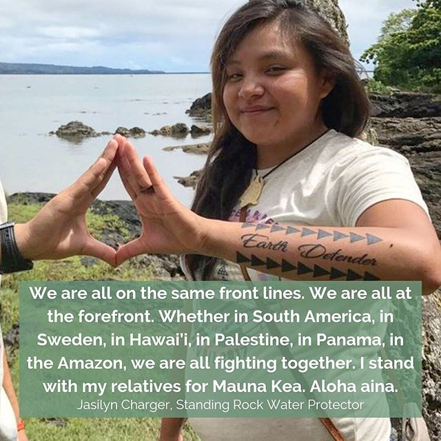 """Standing Rock Water Protector & Earth Defender @jasilyncharger reminds us, """"This isn't about me. It's about making change and knowing anyone is capable of change."""" In our most recent article, she shares the ways that our struggles across the globe are inter-connected, and demonstrates the importance of standing up in solidarity with one another as we fight to protect our sacred homes all around the world. #WeAreMaunaKea #ProtectMaunaKea • 📷: Jasilyn showing a tattoo on her arm that says 'Earth Defender' from a trip she took to Hawai'i as an organizer with @seedingsovereignty"""