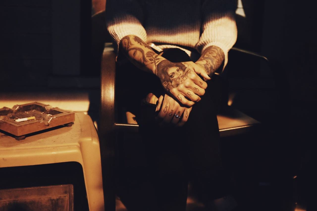 This is my other favorite snapshot from this year. Just a late summer evening on our front porch, hanging with friends, and the light coming onto the porch fell perfectly to highlight my friend  Jessie Felix 's tattoos. - Anthony Ryan Tripoli