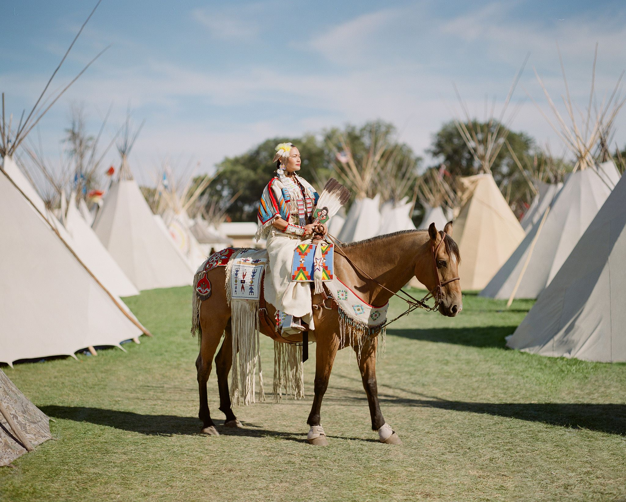 This is my favorite shot of the year. I ran into my friend here on her horse surrounded by a crowd. I had 2 shots left on my roll of film. I asked if I could take her photo and for one second, the crowd happened to be out of the frame. A magical moment for me. - Whitney Minthorn