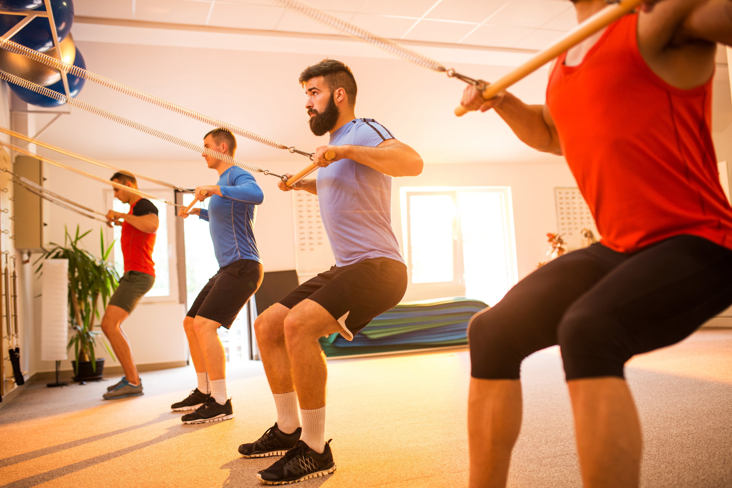 Group-of-sportsmen-exercising-on-Pilates-machines-in-health-club.-637765816_5760x3840.jpeg