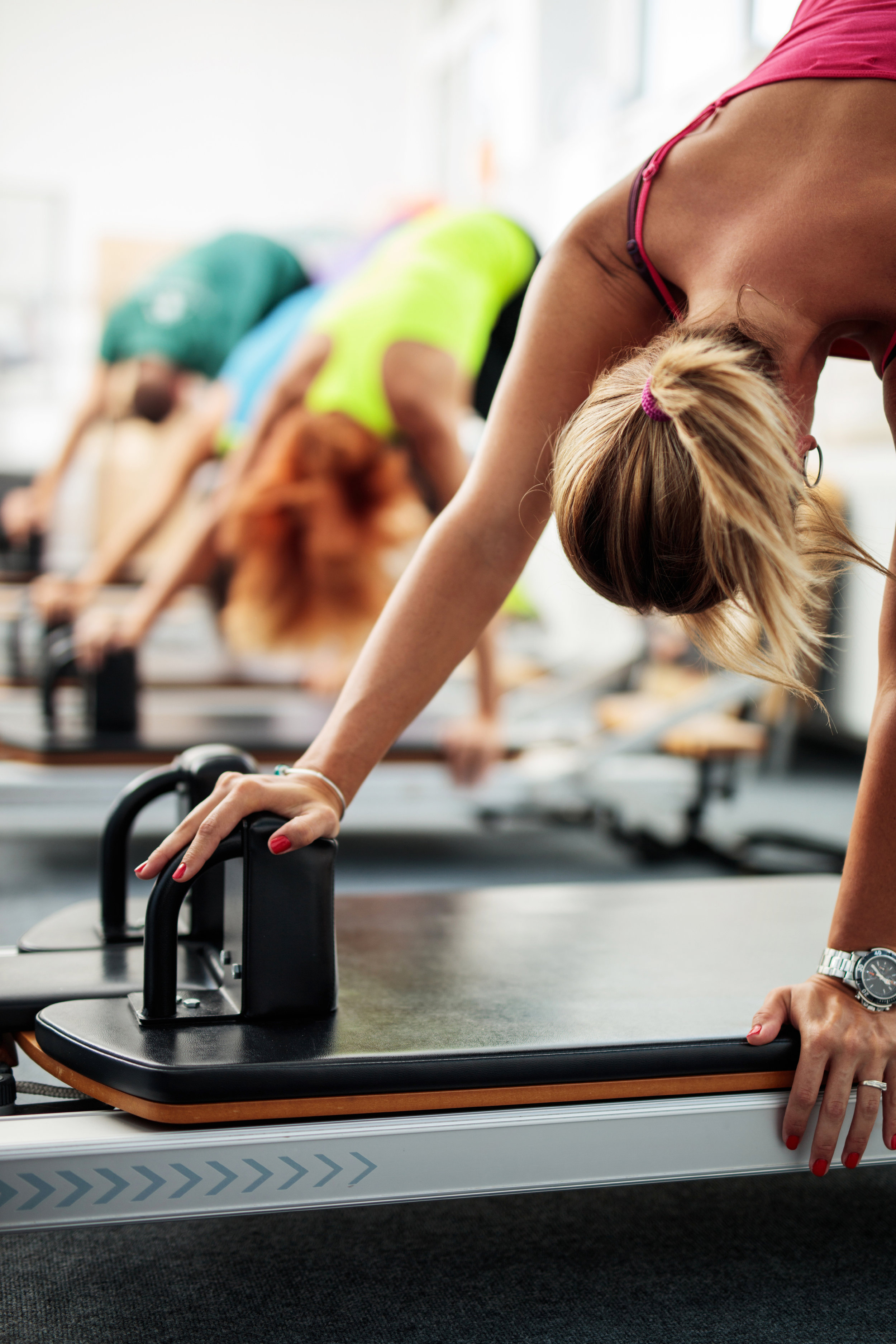Group-of-people-having-a-Pilates-class-on-exercise-machines.-495505980_2579x3869.jpeg