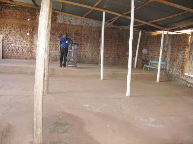 Pastor Luyinda and Church Roof 2.jpg