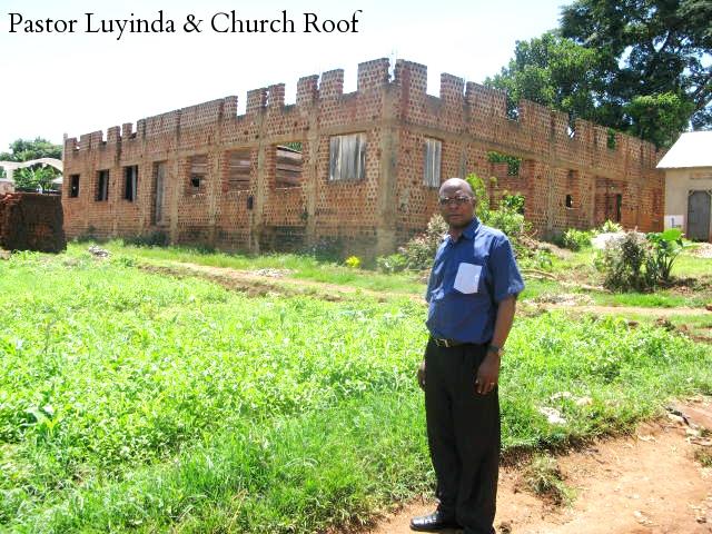 Pastor Luyinda and Church Roof 1.jpg