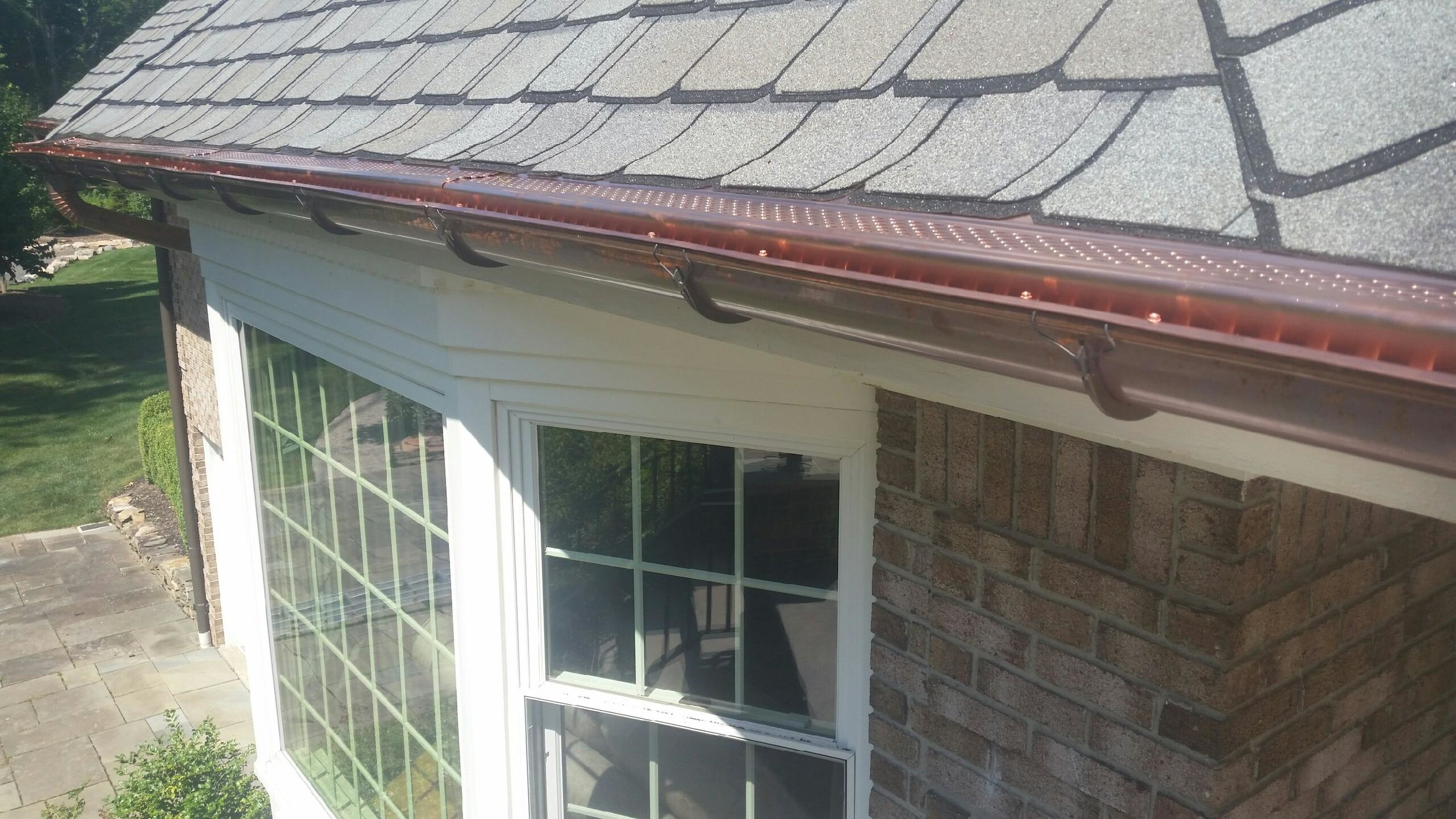 COPPER LEAF PROOF OVER HALF ROUND GUTTERS 1.JPG