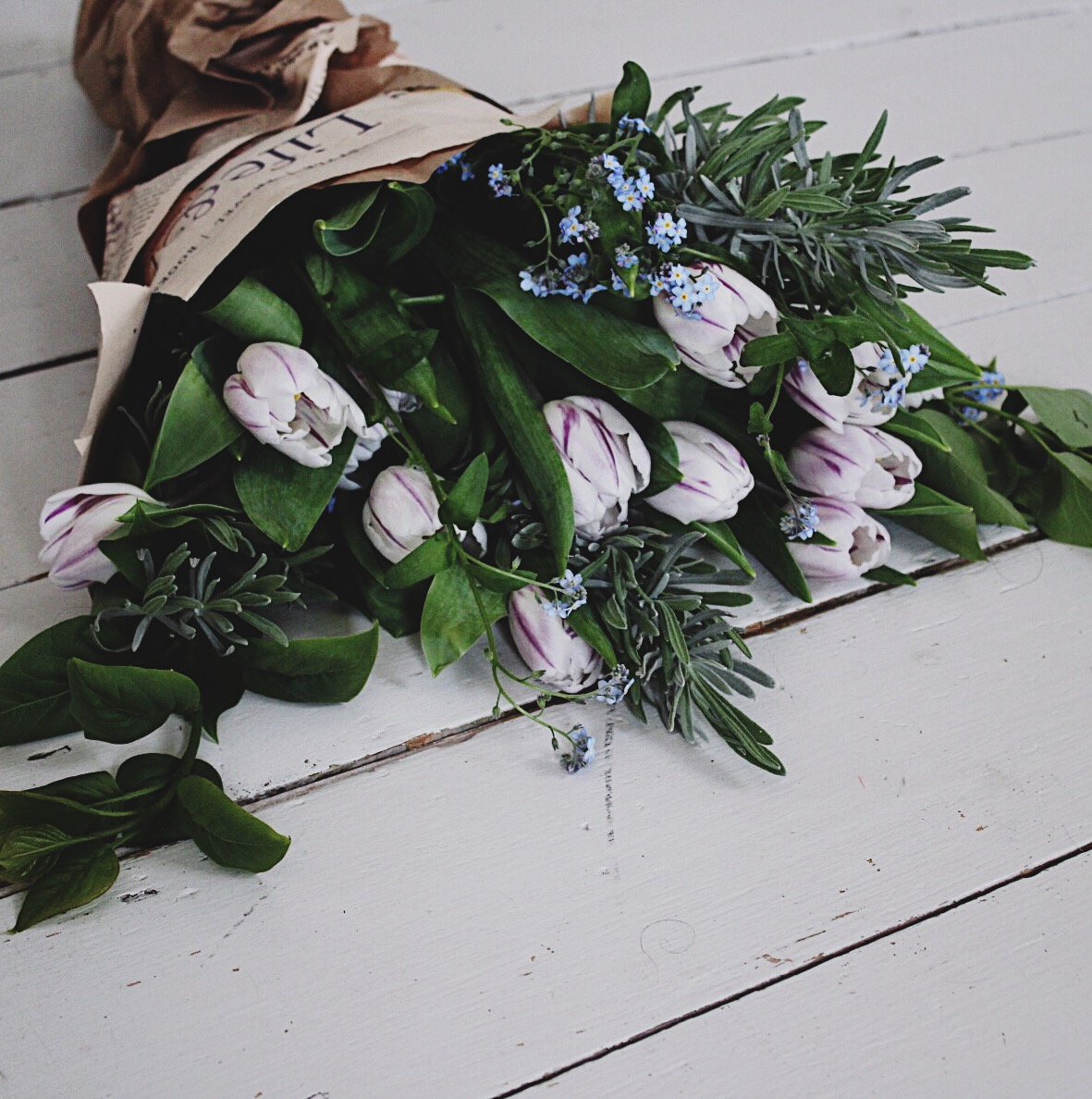 Paint & Haven - Tulips, lavender, forget-me-nots and newspaper, a bouquet of spring garden flower.