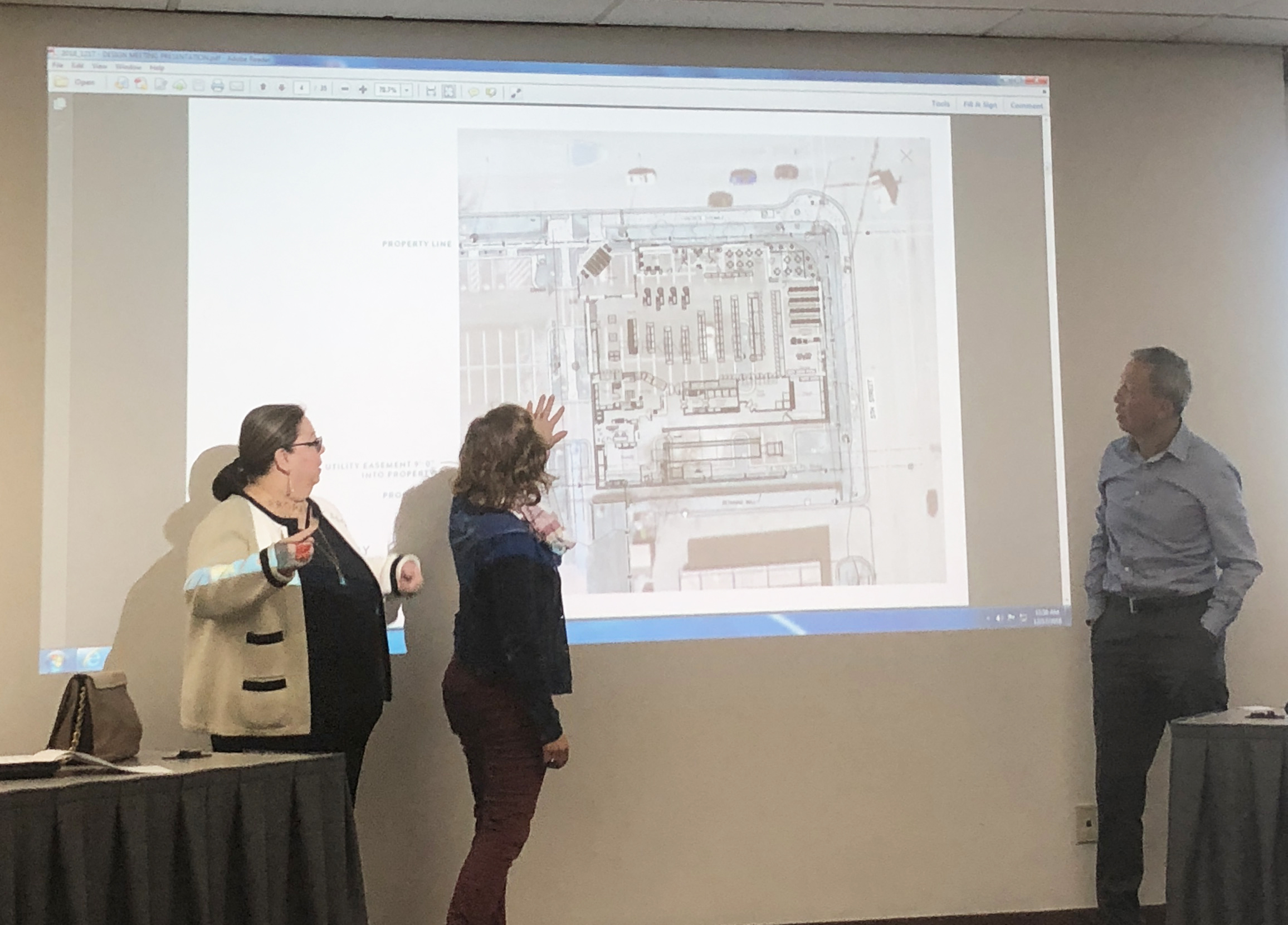 Rita (second from left) discusses the store's layout plans with Elizabeth Amirahmadi of International Architects Atelier and Peter Ho of CBC Real Estate Group.