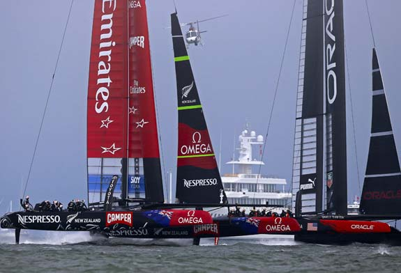 I like this photo because it tells the story of the 34th America's Cup. This photo shows the upwind boat speed that was the America's Cup turning point. On this day in the America;s Cup — race three — Team New Zealand was just starting to foil upwind. This new trick – never done before – gave them a tremendous speed advantage over Team Oracle which was sailing upwind with a hull in the water, creating drag and slowing them down. Foiling past Larry Ellison;s Superyacht Musashi, TNZ showed off this new ability on Day 3. This upwind speed led TNZ to an  8-1 lead in the America's Cup before Oracle started foiling upwind also, surging ahead. Improving daily, making the biggest comeback in the 162 year history, Oracle went on to win the 34th America's Cup.- they were simply faster, due mainly to upwind foiling.