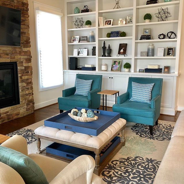 A little bit a bookshelf styling makes a huge difference! #interiordesign #homedecor #accessories #staging #dcdesigner #bookshelves #builtins #blue #teal #beforeandafter #familyroom #finaltouch #homegoodshappy