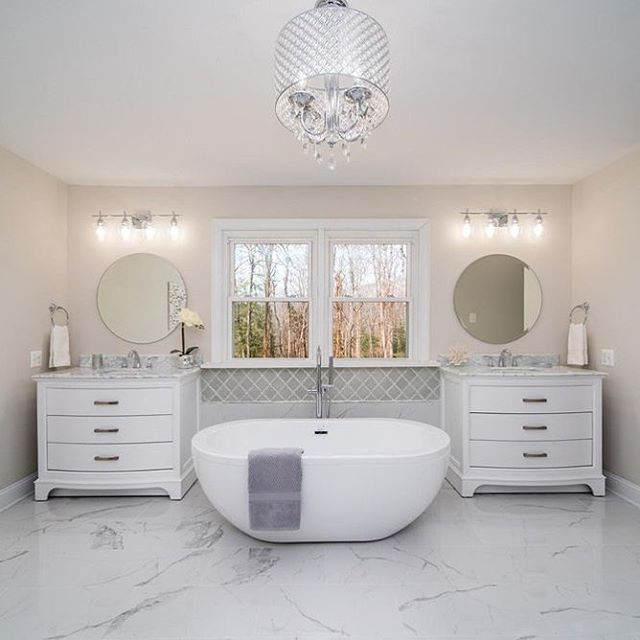 Look at this gorgeous bathroom in person, at an open house coming soon! This whole house is something right out of my design portfolio. I'm so excited to be selling it! Nestled on 16 acres in LaPlata Maryland.  Just beautiful! #sellinghomes #interiordesign #bathroomdesign #whitebathroom #openhouse #realestate #thereynoldsteam #maryland #laplatamd #welcomehome #spabath #freestandingtub #vanities