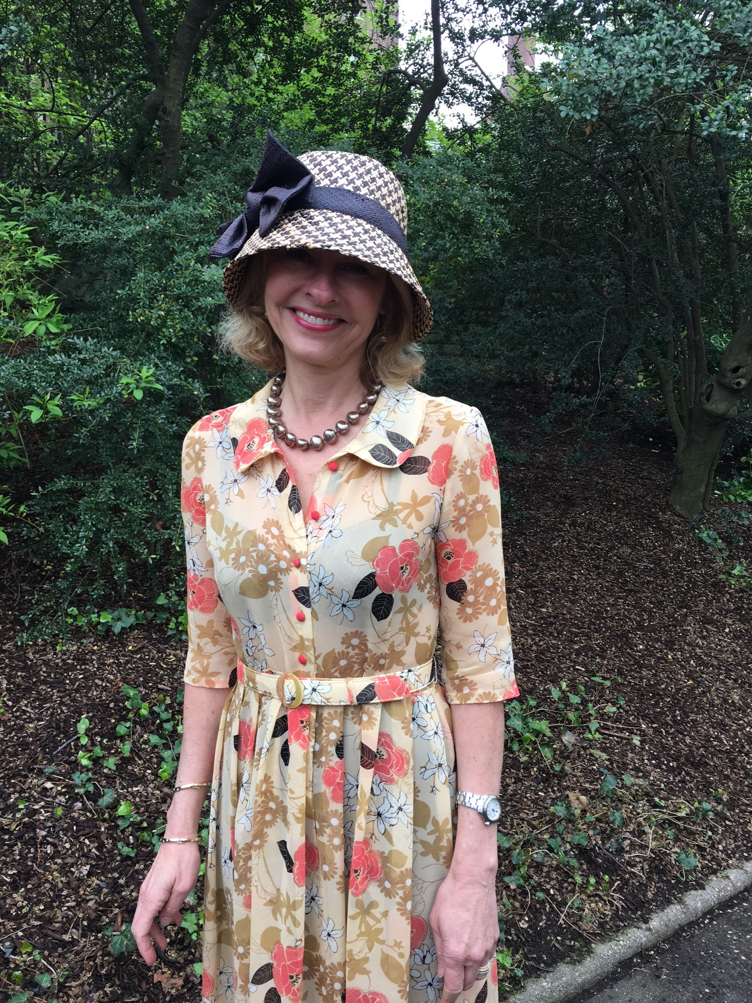 """Laurie Eustis in Flowered chiffon dress at Conservatory """"Hat"""" Luncheon"""