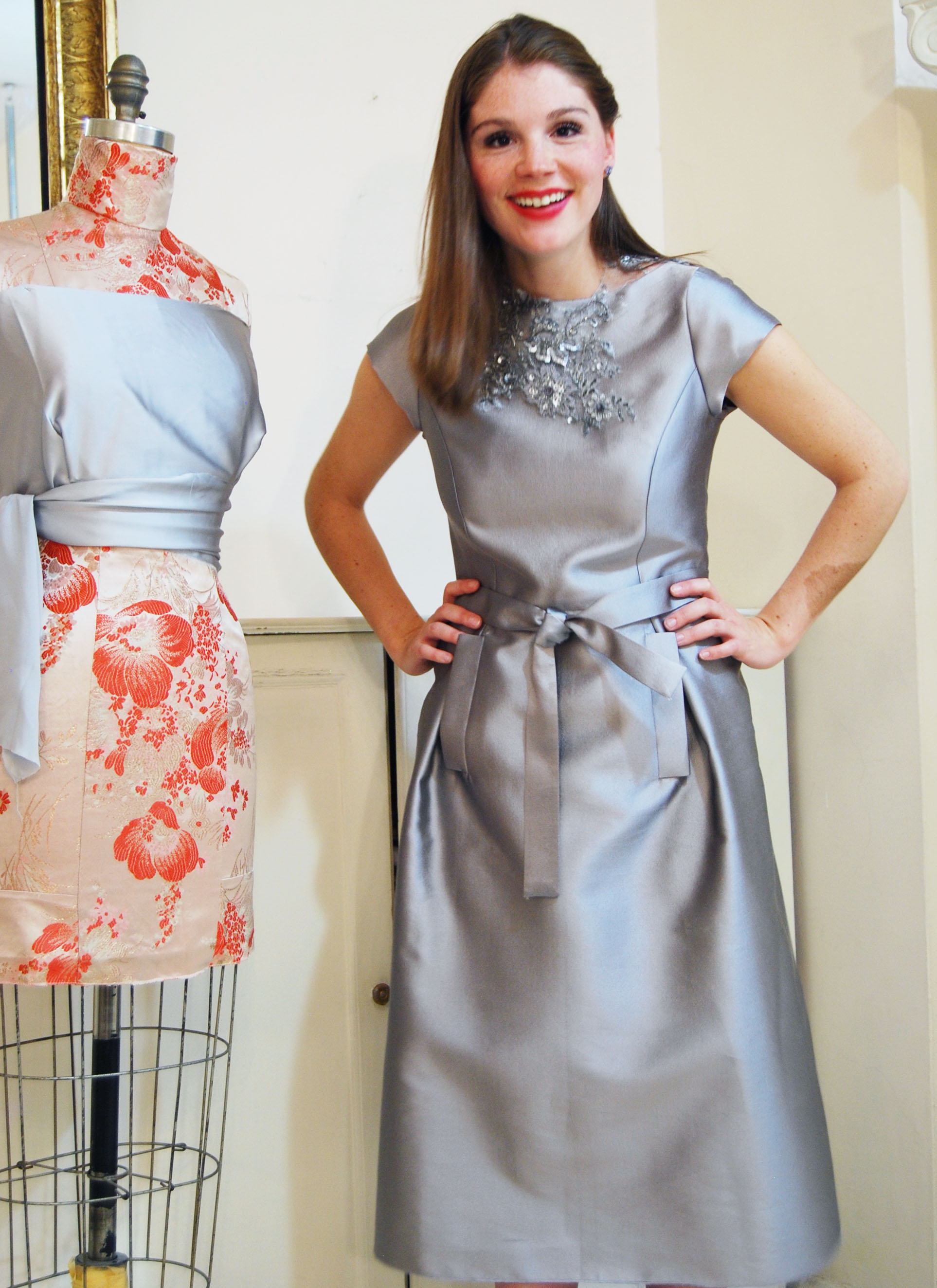 Silver silk/wool blend. with pockets and tie belt. Lace necklace is separate from the dress.