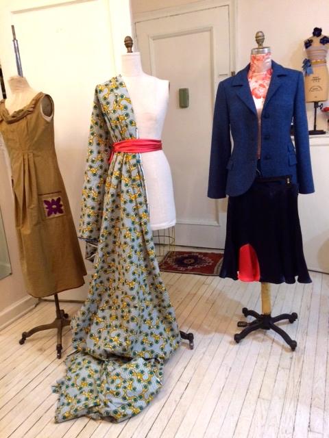Appliqué cotton dress, draped wax-print, wool jacket, silk charmeuse skirt