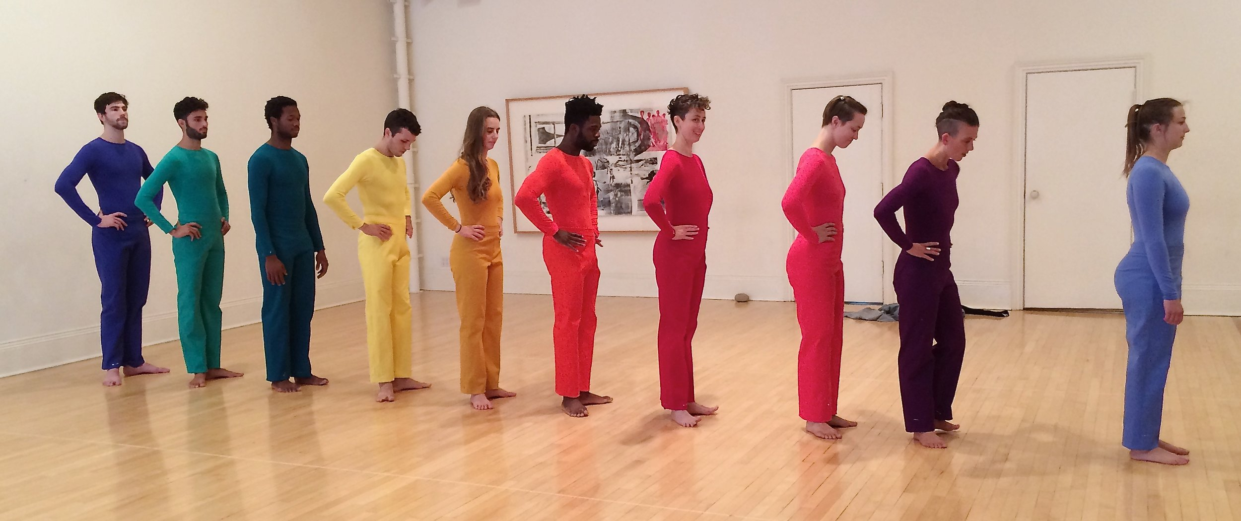 checking the pant hems in the rehearsal studio