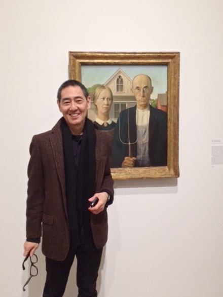 My husband, Artist Taro Suzuki, in front of Grant Wood's most famous painting -  American Gothic