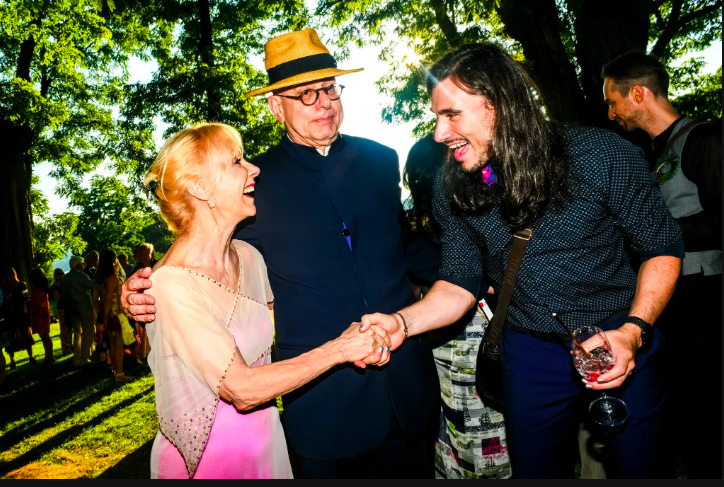 """Barbara Haskell, Whitney Museum curator, at the Bard Summer gala, with her husband, Leon Botstein, president of Bard.  She is wearing the """"Jumeliere Dress""""  sequined and beaded net over fushia silk under slip."""