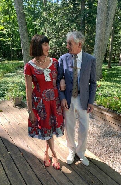 Eve Vaterlaus wearing my multi-print red Poppy dress and husband Donald Sheriden in Harbor Springs Michigan