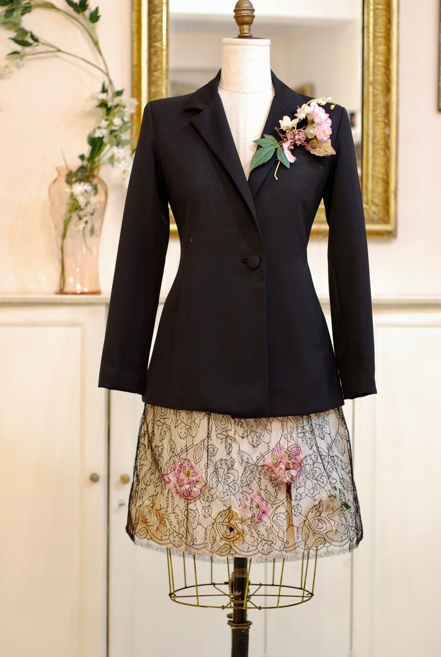 Black English wool jacket with flower and lace adorned silk shantung skirt
