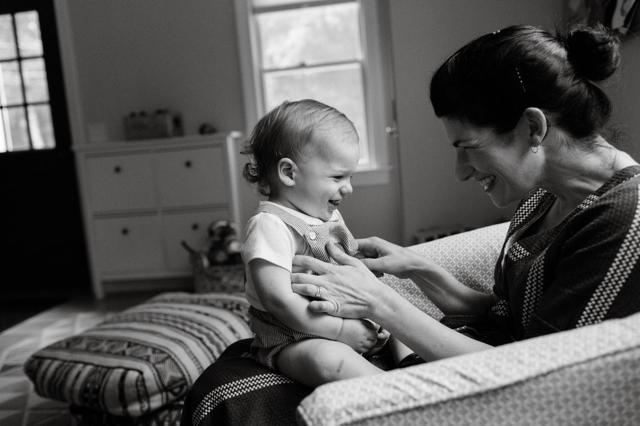 mom tickling baby boy